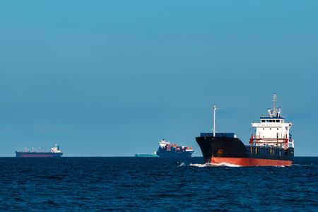 Black bulker ship. Logistics and merchandise transportations Standard-Bild - 102028002