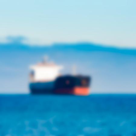 Cargo ship - soft lens bokeh image. Defocused background Stock Photo