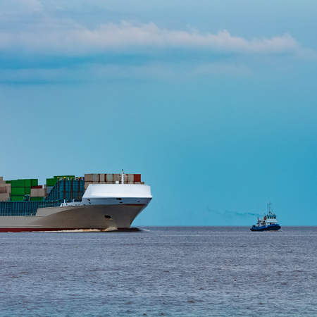 Grey container ship. Logistics and production import Stock Photo