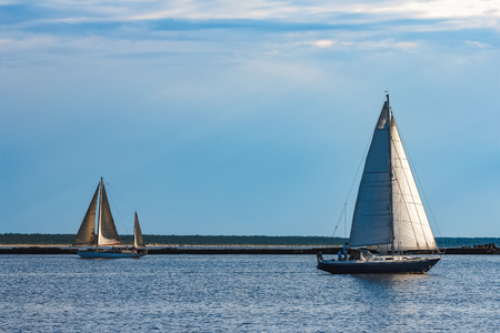 Blue sailboat in the travel by Europe. Sea journey Stock Photo