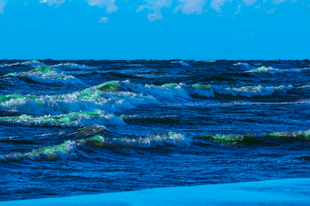 Summer ocean beach with green waves at sunny day