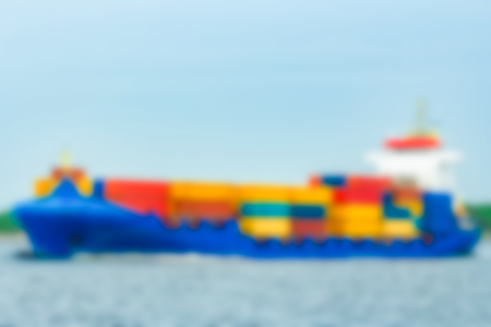 Cargo ship - soft lens bokeh image. Defocused background Фото со стока
