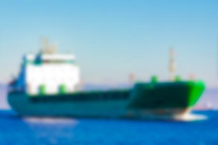 Cargo ship - soft lens bokeh image. Defocused background 写真素材