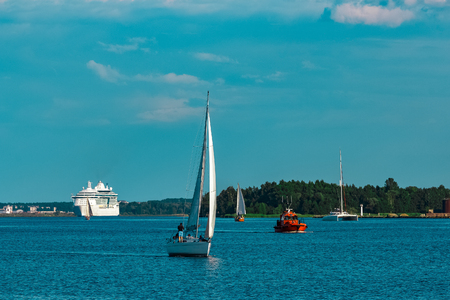 Beautiful white sailboat in a travel by Riga. Summer journey