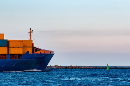 Blue container ship. Global logistics and merchandise transfer 写真素材
