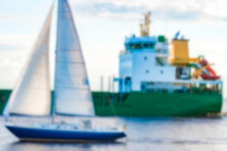 Blue sailboat - soft lens bokeh image. Defocused background