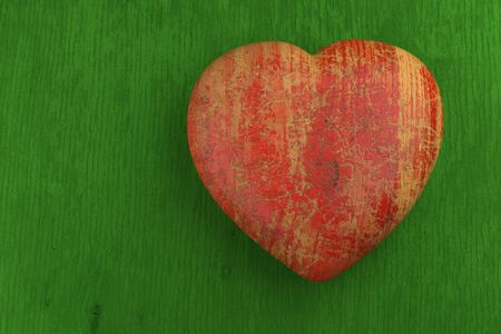 Red wooden heart on green background, texture  Valentines day card