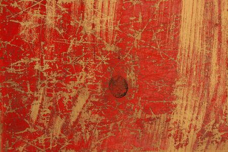 Red painted scratched wood board background, texture