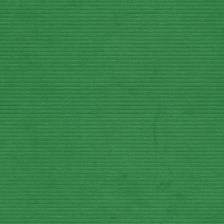 Closeup green cardboard texture, background  Lined relief paper  Seamless pattern