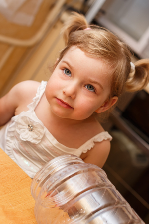 countenance: Portrait of the girl at a table