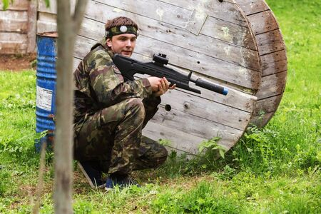 laser tag: Play laser tag on a special testing ground in spring forest. Vitebsk, Belarus 2015 Editorial