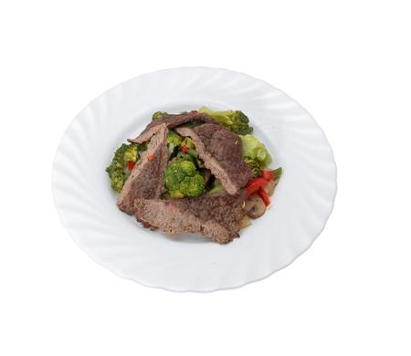 Rindfleisch Fleisch, Gemüse und grüne Pflanzen.