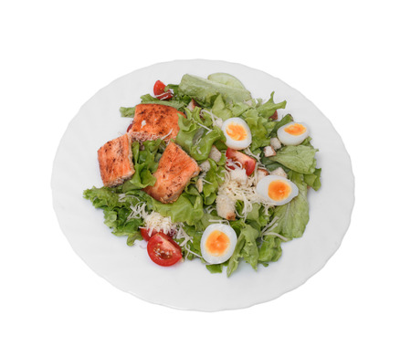 Vegetable salad with cheese, eggs and Red fish.