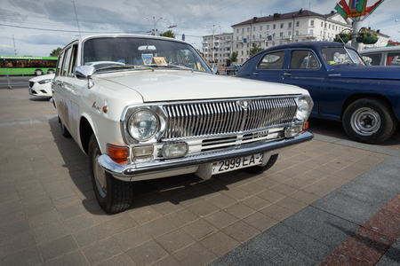 White GAZ M24 Volga  at exibition of vintage cars. Summer. Belarus. Vitebsk. 2017.
