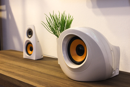 modern designer speakers on wooden sideboard