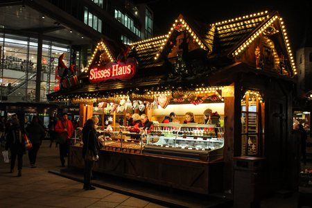 German Christmas Market stall with sweets Editorial