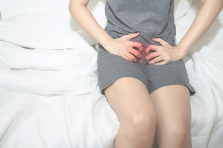 Asian women With itching Female genitalia.Itching of the female organs.