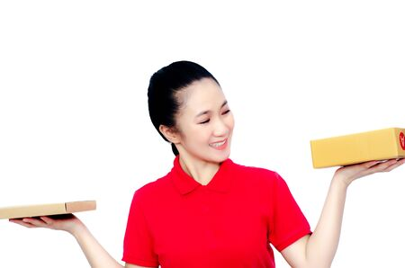 Asian women in a red shirt, blue pants, she smiled and held several brown boxes at the same time isolated white background. Women send parcels.