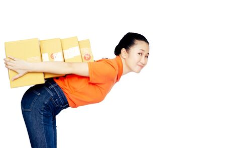 Asian women a orange shirt, blue pants, she smiled and held several brown boxes at the same time isolated white background.Happy woman successful.Copy space.