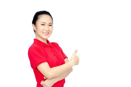 Asian women in a red shirt, blue pants, she smiled and held several brown boxes at the same time isolated white background.Women send parcels. Reklamní fotografie