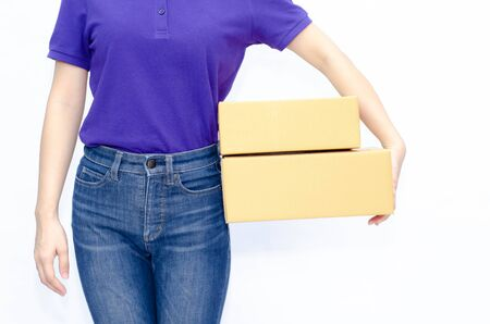 Asian women in a purple shirt, blue pants, she smiled and held several brown boxes at the same time isolated white background.Women send parcels.Do not focus on objects.