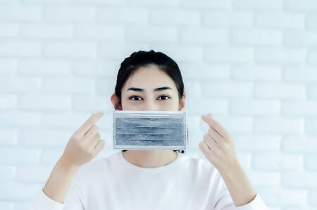 Asian girl wearing a black mask.Nose mask protects against dust on the face of  women.Blurred image for background use.