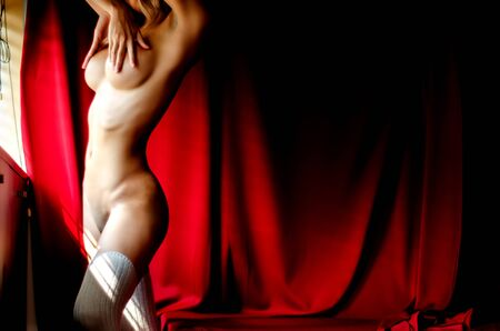 Beautiful women without clothes With a red background in the room.Dark tone decoration And add grain to the image.photos of nude female art.Do not focus on objects. Stock Photo