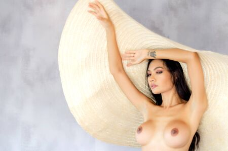 Beautiful and sexy women wearing big hats and wearing shirts.Blurred image for background use.