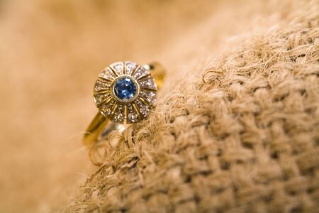 Beautiful  gold ring with rocks and hemp. photo