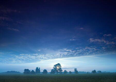 Beatiful and calm sunrise. Colourful landscape. photo