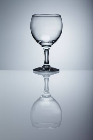 filled: Empty wine glass isolated over background Stock Photo