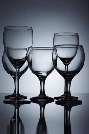 Empty wine glass isolated over background photo