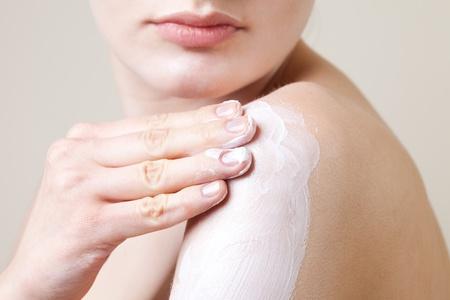 Woman putting cream