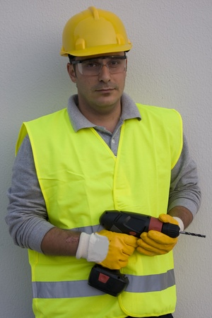Man drilling a hole on a wall Stock Photo - 9400285