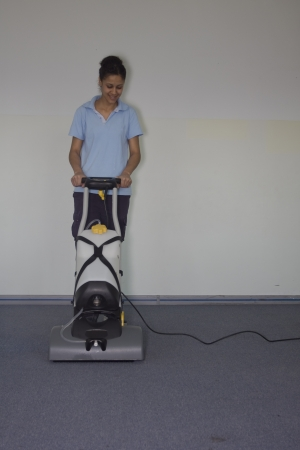 A worker is cleaning the carpet photo