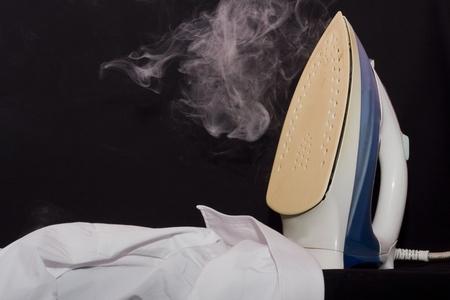 ironing board: close up of ironing tool on white background
