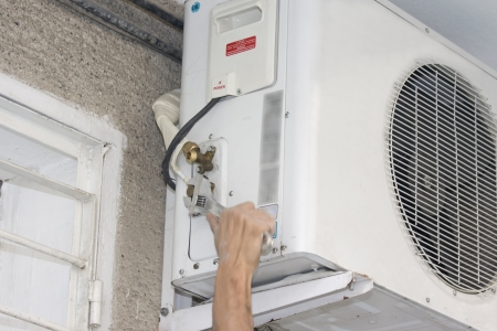 a unit: A residential central air conditioning unit
