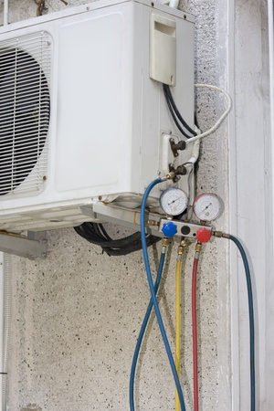 testing A residential central air conditioning unit