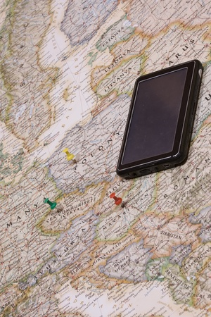 differential focus: different color of pushpins showing the location of a destination point on a map Stock Photo