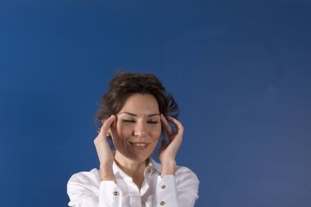 Image of young woman thinking on blue board  Stock Photo - 11310690