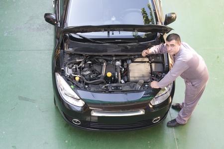 mechanic working in auto repair shop. photo