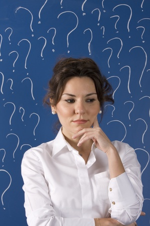 thinking business woman in front of question marks written blackboard Stock Photo - 11557926