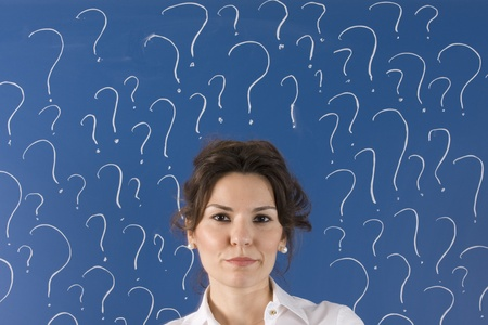 thinking business woman in front of question marks written blackboard  Stock Photo - 11557914