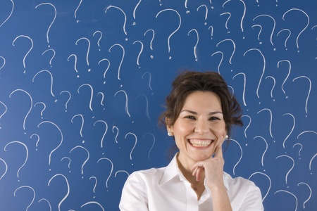 thinking business woman in front of question marks written blackboard Stock Photo - 11645793
