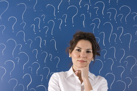 thinking business woman in front of question marks written blackboard  photo