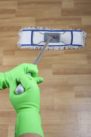 cleaner mopping floor in office  photo