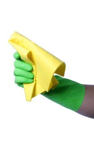 Hand with green glove holding cleaning napkin; isolated on white  photo