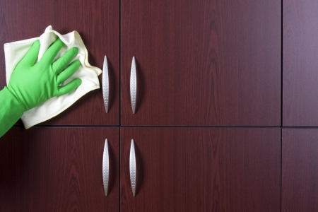 wipes: cleaner hand polishing the door of closet  Stock Photo
