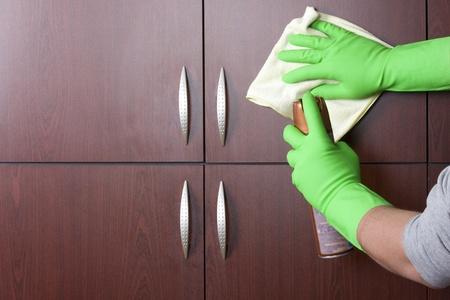 closet door: cleaner hand polishing the door of closet  Stock Photo