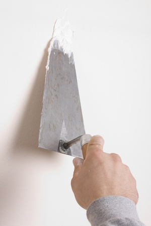 Putty Knife with Paste to Repair Wall Damage  Stock Photo - 12149600